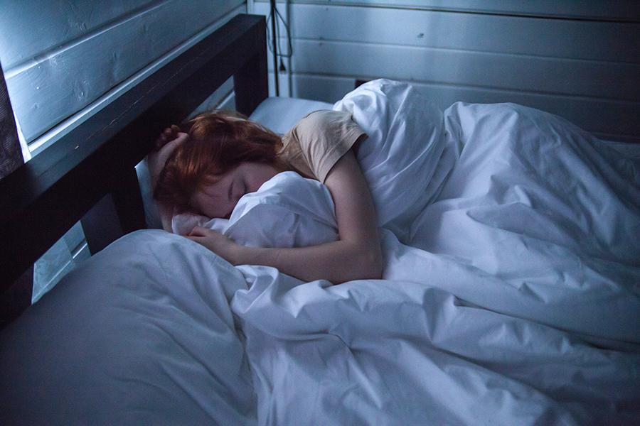 adult-asleep-bed-900x600